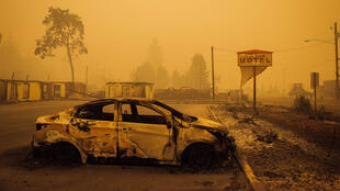 A charred vehicle is seen in the parking lot of the burned Oak Park Motel after the passage of the Santiam Fire in Gates, Oregon, on September 10, 2020.