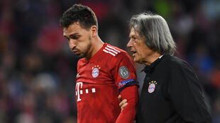 Hans-Wilhelm Mueller-Wohlfahrt pictured helping Mats Hummels off the pitch when he played for Bayern Munich in October 2018