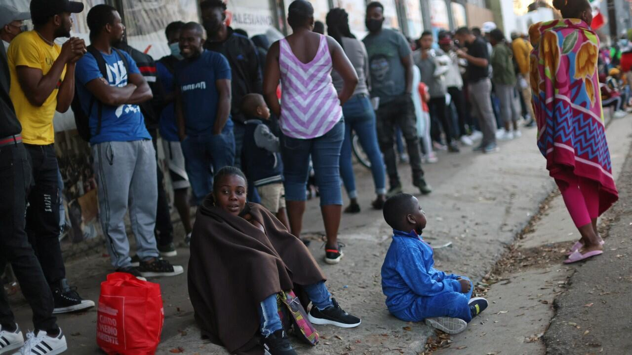 Migrants from Haiti line up to regularize their immigration status outside the Mexican Commission for Refugee Assistance (COMAR), in Tijuana, Mexico, on September 29, 2021.