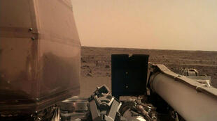 File image of the Martian surface taken by NASA's InSight robot on November 26, 2018, the day it landed on the red planet.