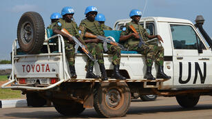 UN peace keepers secure a section of the airport on August 12, 2014 as members of the United Nations Security Council arrive in the South Sudanese capital, Juba