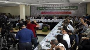 ممثلون عن المجتمع المدني يجتمعون لدعم الاحتجاجات في الجزائر العاصمة في 15 يونيو/حزيران 2019.