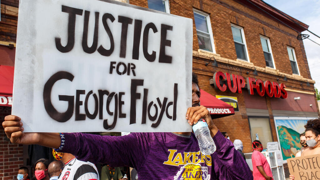 US policeman who knelt on neck of black man George Floyd charged with third-degree murder
