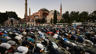 Muslims gathered outside the Hagia Sophia on Friday to celebrate the court decision that cleared the way to converting it back to a mosque