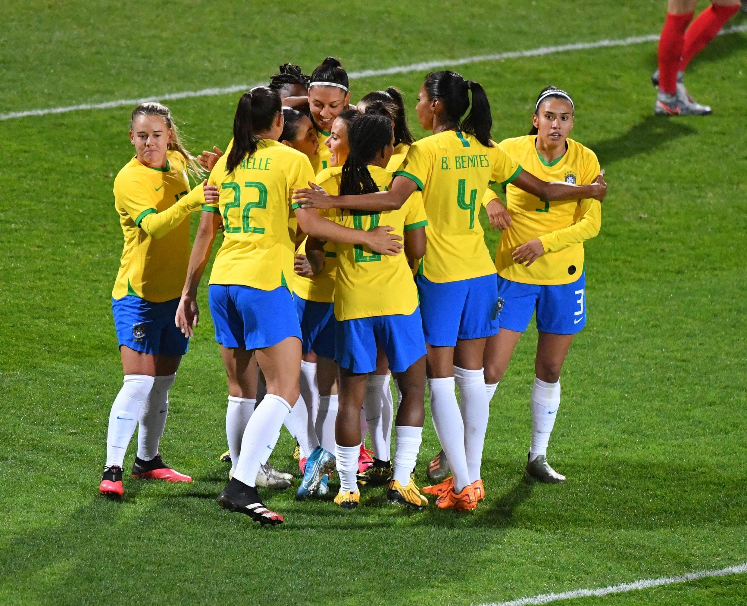 Brazil's Marta Silva (hidden) is congratulated by teammates after scoring a goal during a football match against Canada in Calais, northern France, on March 10, 2020.