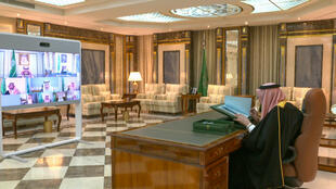 Saudi King Salman, seen in this July 22, 2020 image grab taken from a official video released by the royual court chairing a virtual cabinet meeting from hospital, has underwent a successful operation to remove his gall bladder, state media said