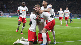 RB Leipzig, seen here celebrating a goal against Tottenham, are working on modified goal celebrations -- to avoid contact -- when the Bundesliga resumes Saturday.