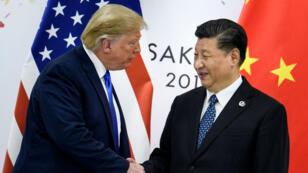 Donald Trump et XiJinping avant une réunion bilatérale en marge du sommet duG20 à Osaka, le 29juin2019.
