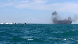Iran's elite Revolutionary Guard attacks a vessel during a previous drill in the Strait of Hormuz in 2015