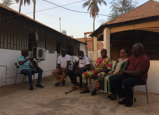 "Super Mama Djombo band members reunite in Bissau to play their famous song ""Dissan Na M'Bera""."