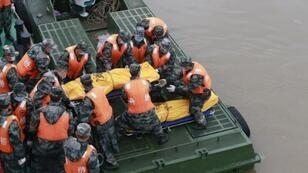 """Rescue personnel on June 3, 2015, recover the bodies of victims who were on the ill-fated """"Eastern Star"""" cruise ship."""
