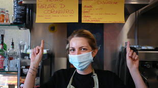 Cristina Mattioli, manager of the Feeling bar, put up one poster banning virus talk and another offering other ideas for conversation.