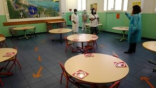 School employees prepare the refectory of the Rothschild school in the French Riviera city of Nice, southern France, on May 11, 2020, as schools in France are to gradually reopen with the partial lifting of the lockdown.