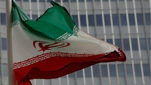 An Iranian flag flutters in front of the International Atomic Energy Agency (IAEA) headquarters in Vienna, Austria, on September 9, 2019.
