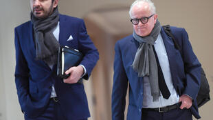 Fritz Keller (R), president of the German Football Association is leading a move to introduce a salary cap