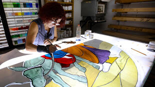Lebanese stained glass artist Maya Husseini works on a window, one of several artists striving to restore artworks devastated in Beirut's blast disaster