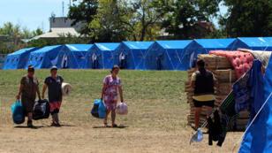Des réfugiés ukrainiens dans un camp près de Sébastopol, en Crimée .