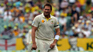 Former Australia bowler Ryan Harris shines the ball