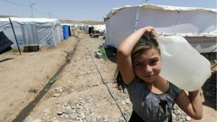 Une Kurde de Syrie réfugiée dans un camp situé à 20 kilomètres d'Erbil (Irak).