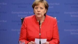 المستشارة الألمانية أنغيلا ميركل في مؤتمر صحافي في 29 من حزيران/يونيو 2018