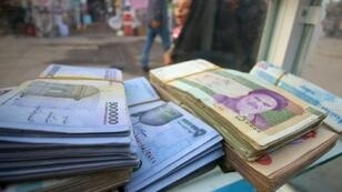 The zeros have piled up on Iranian banknotes but their purchasing power has plummeted, with the rial now changing hands at around 120,000 to the dollar