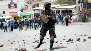 L'opposition hondurienne manifeste pour dénoncer les résultats de l'élection présidentielle du 26 novembre.