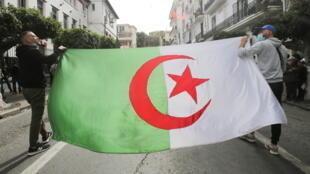 2021-04-02T161342Z_448127944_RC2SNM96YFKL_RTRMADP_3_ALGERIA-PROTESTS
