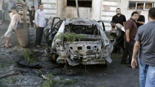 Une des voitures du Hamas et du Jihad islamique plastiquées dimanche 19 juillet à Gaza.