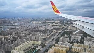 Urumqi in China's Xinjiang province has curtailed most flights into the city and shut down subway and public bus services after several coronavirus infections were detected