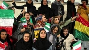 Iranian women take a selfie during the friendly football match between Iran and Bolivia at the Azadi Stadium in Tehran on October 16, 2018