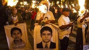 Students of the Ayotzinapa school and parents of the 43 missing students take part in a protest in Guadalajara City on November 18.