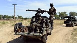 Cameroonian soldiers patrol on November 12, 2014 in Amchide, northern Cameroon.