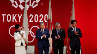 FILE PHOTO : Tokyo Governor Yuriko Koike, Tokyo 2020 President Yoshiro Mori, International Olympic Committee (IOC) President Thomas Bach and Japan's Prime Minister Shinzo Abe attend the 'One Year to Go' ceremony celebrating one year out from the start of the summer games at Tokyo International Forum in Tokyo, Japan July 24, 2019.