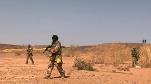 Nigerien commandos simulate a raid on a militant camp during the US-sponsored Flintlock exercises in Ouallam, Niger, April 18, 2018.