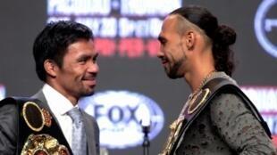 Le Philippin Manny Pacquiao (g) et l'Américain Keith Thurman à Las Vegas pour la couronne WBA des Welters le 17 juillet 2019