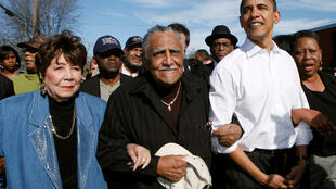 Barack Obama walks with Reverend Joseph Lowery (centre) during a march commemorating the 1965 Selma-Montgomery Voting Rights March in Selma, Alabama, March 4, 2007.