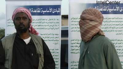 US-born Abu Abdullah al Muhajir (right) and senior al Shabaab spokesman Ali Mahmud Rage (left) make an appearance at a refugee camp south of Mogadishu in October 2011. (Picture provided by IntelCenter)