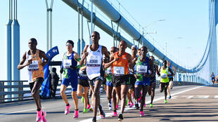 Runners cross the Verrazzano-Narrows Bridge during the 2019 TCS New York City Marathon in New York City on November 3, 2019.