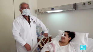 Plastic surgeon Nabil Hakayem with his patient Mabelle, who was badly injured by the Beirut port explosion on August 4, 2020.