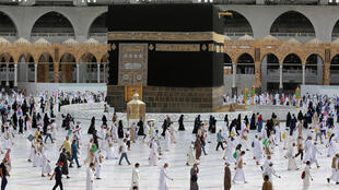 Pilgrims circle Islam's holiest site, the Kaaba, along socially distanced paths Sunday in the final ritual of the hajj