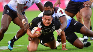 Canberra Raiders player Joseph Tapine, seen here being tackled as he played for the New Zealand national side, is one of a number of NRL players reportedly refusing to have a flu vaccination