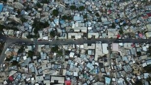 An aerial view of the houses in the neighborhood of Fort National in Port-au-Prince show how they are piled on top of one another -- one indication of the city's endemic poverty