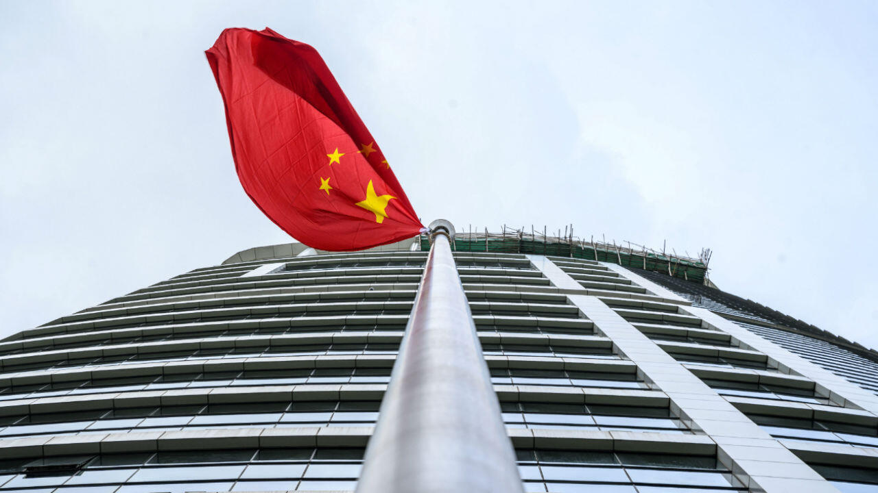 A Chinese flag flutters outside the new Office for Safeguarding National Security of the Central People's Government in the Hong Kong Special Administrative Region after its official inauguration on July 8, 2020.