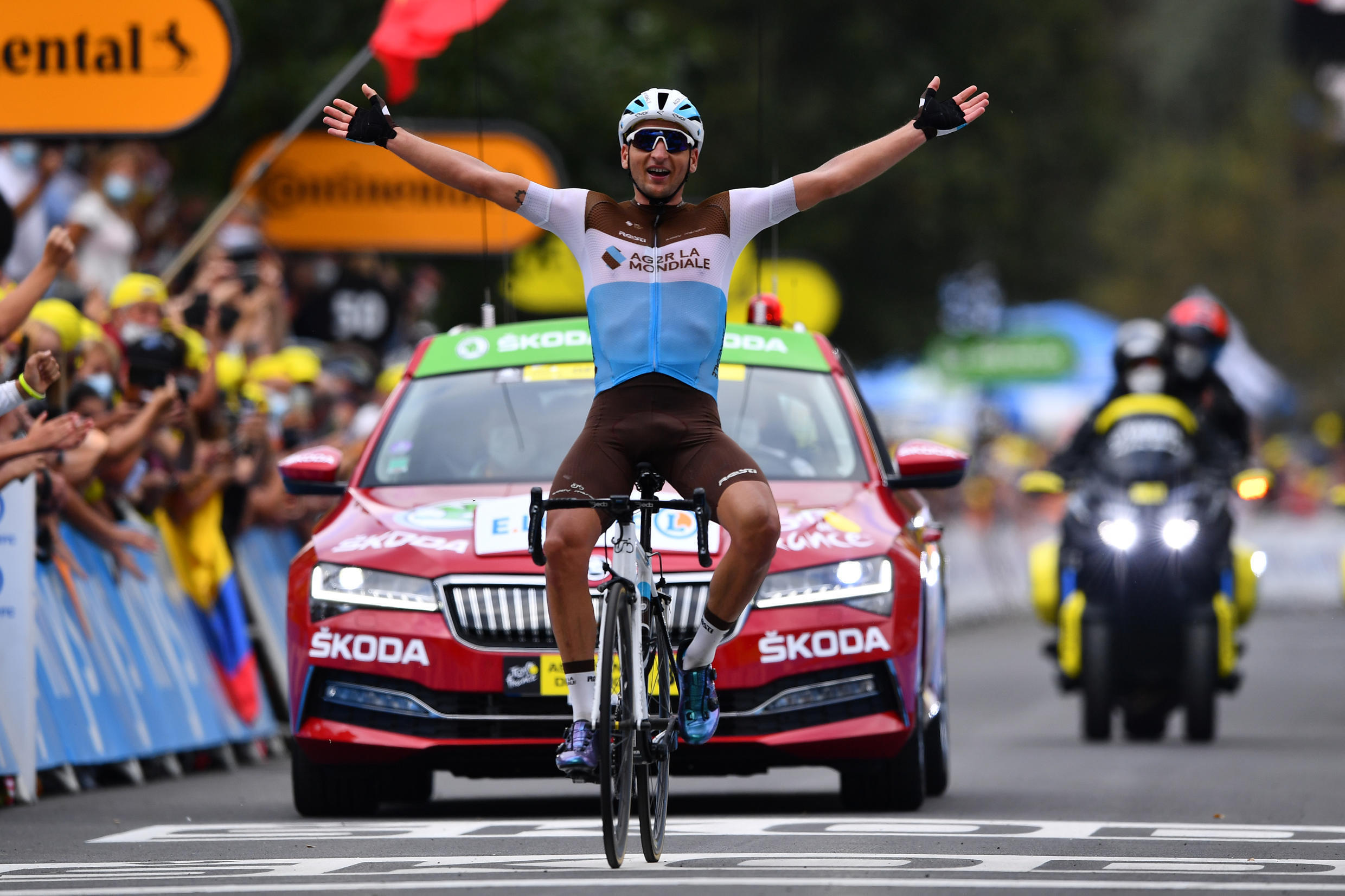 France's Nans Peters celebrates as he crosses the finish line