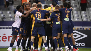 Paris Saint-Germain players celebrate after beating Lyon on penalties in the French League Cup final
