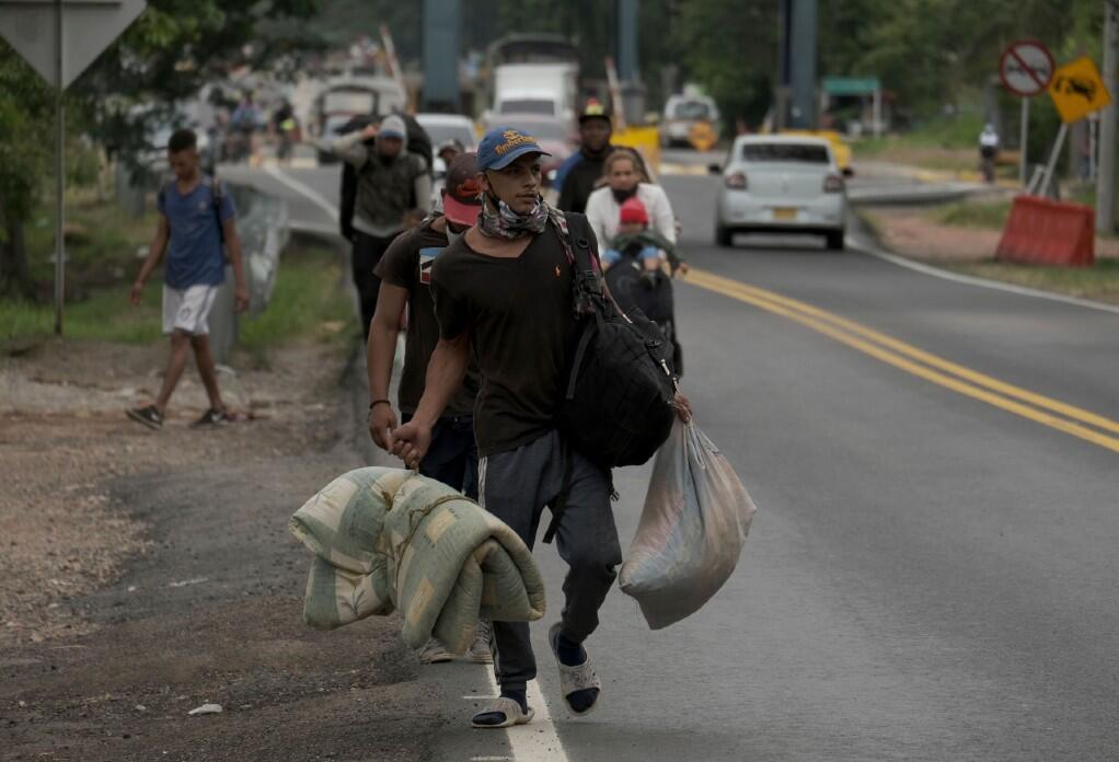 A Venezuelan migrant family moves away from the Venezuelan border in Pamplona, Colombia, on Wednesday, October 7, 2020.