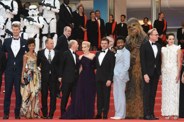 """Storm troopers stand guard during the premiere for """"Solo: A Star Wars Story""""."""