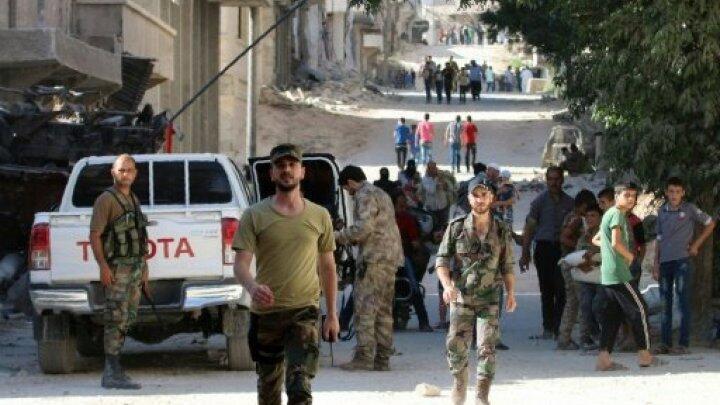 عناصر من قوات النظام السوري في حلب