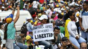 Des soutiens à l'opposant Juan Guaido manifestent à Caracas, le 6avril2019.