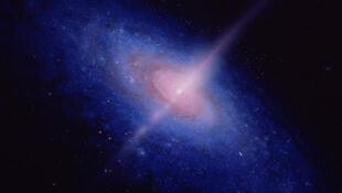 Une vue d'artiste d'une galaxie active, centrée sur un trou noir.